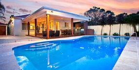 Swimming pool at dusk backyard view