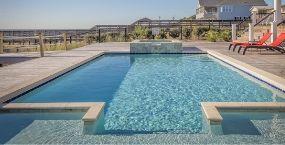 long swimming pool behind stockton house