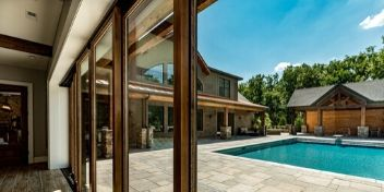 modern wood and stone home with swimming pool